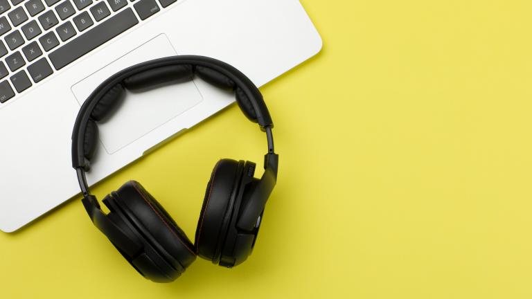 Photo of Black Headphones and Laptop Keyboard